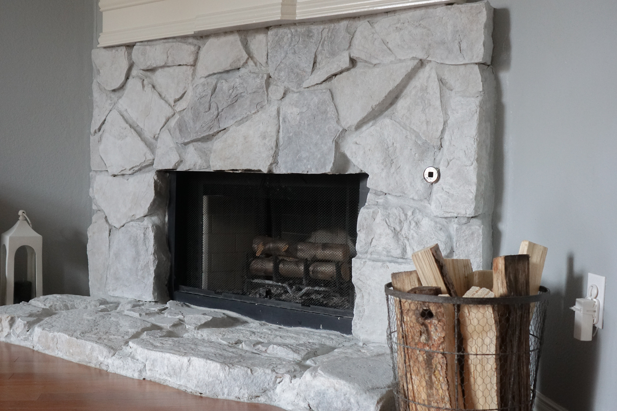 How to Whitewash a Stone Fireplace
